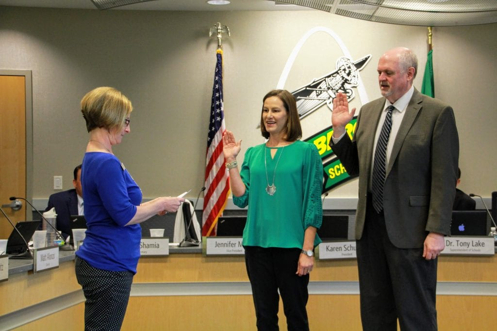 Lindbergh+board+President+Karen+Schuster%2C+left%2C+swears+in%2C+from+left%2C+Jennifer+Miller+and+Mike+Tsichlis+to+their+second+terms+on+the+Lindbergh+school+board.