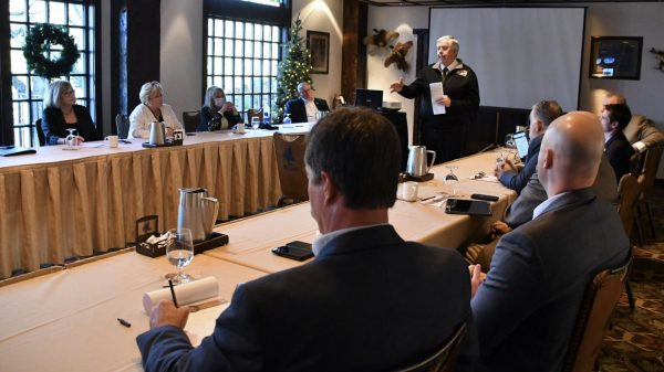In a photo tweeted by Gov. Mike Parson, Parson speaks at a Branson retreat last week to Missouri senators who were not wearing masks including, second from right, Sen. Andrew Koenig, R-Manchester, who represents Sunset Hills, and third from right, Sen. Paul Wieland, R-Imperial, who represents Arnold.
