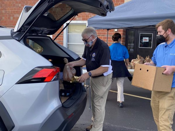 Rep. Jim Murphy, R-Oakville, pictured above, and Rep. David Gregory, R-Sunset Hills, hosted a food distribution event at Mehlville High School in September.