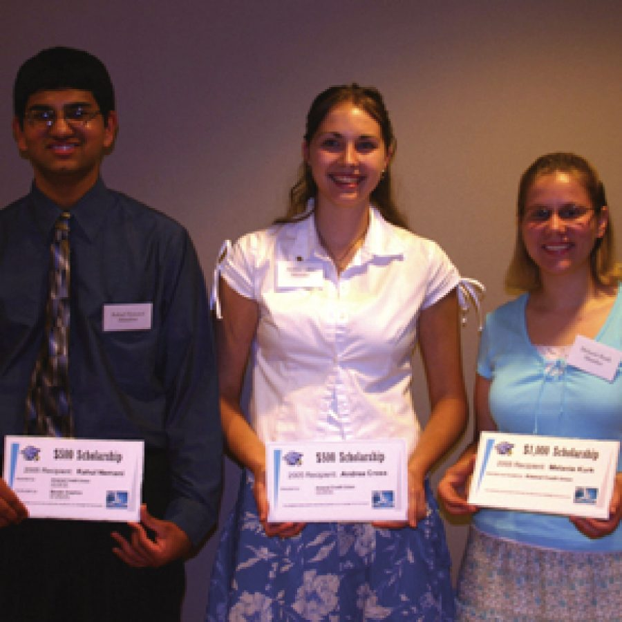 Arsenal Credit Union scholarship recipients, from left, Rahul Nemani, Andrea Cross and Melanie Kurk display their scholarship certificates at the presentation ceremony. Not pictured is Sarah Rouland.