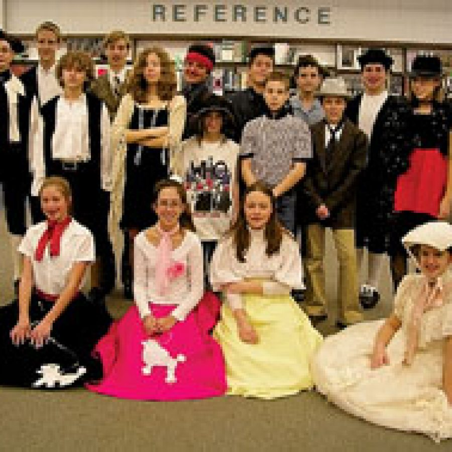 These STRETCH pupils at Washington Middle School show off the period clothing they donned for their 'Building of America' Newseum project.