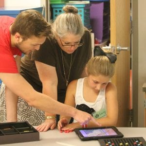 Lindbergh graduate teaches coding to Camp Ignite students at Concord