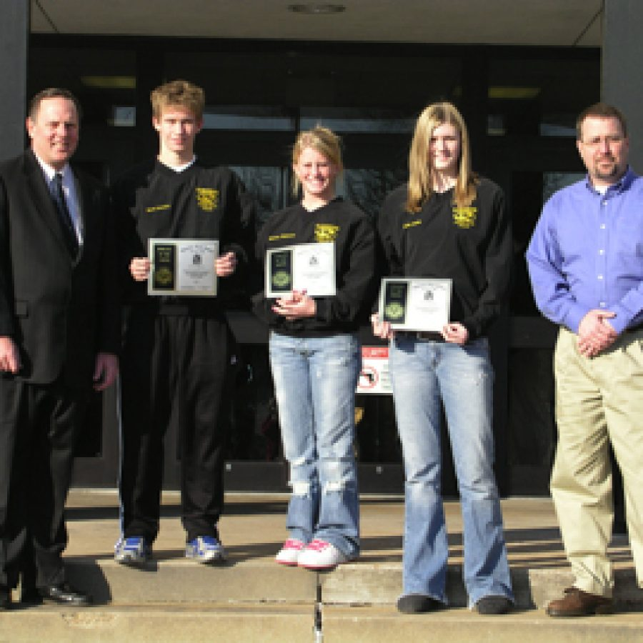 Three Oakville Senior High students recently received 'Athlete of the Month' honors. Pictured, from left, are: Donald Olenyik of Edward Jones Investments, Scott Greubel, Miriam Wegmann, Emily Austin and Don Beile of Priority One Promotional Products and Services.