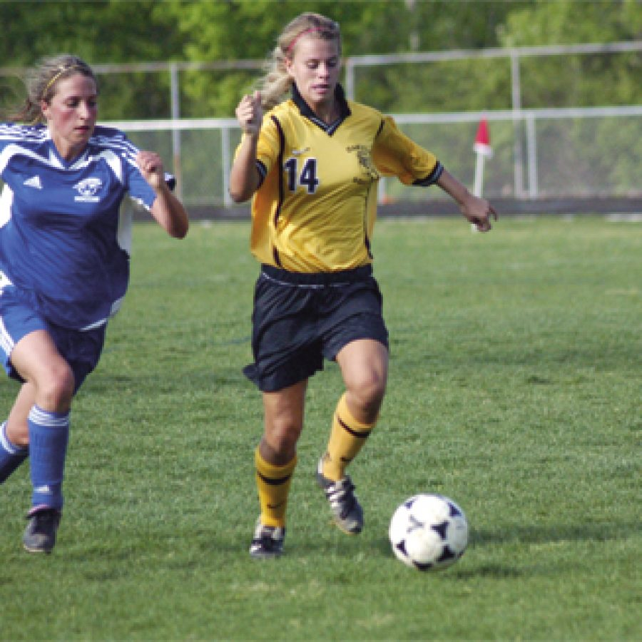 Oakville senior Jenna Milward breaks past a Northwest defender on her way to her second goal in Oakville's 7-0 victory over the Lions.