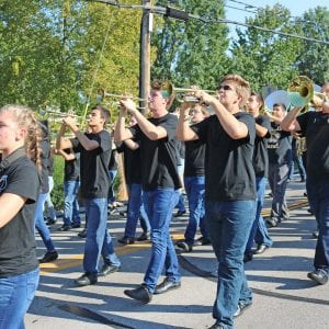 The Oakville High School Tiger Band perform in a parade.