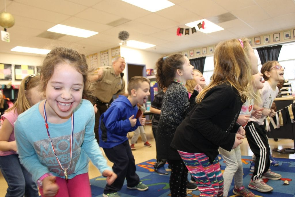 Oakville Elementary kindergarteners do the 'footy-ta' dance in January 2019.