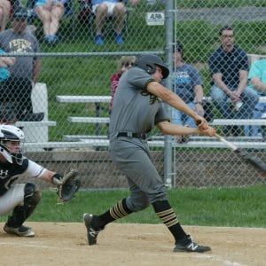 A Festus player at bat. Oakville held the team back, six runs to four.