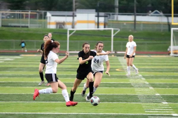 Fox (white) and Oakville (black) compete May 18 in the hard-fought semifinal win for the Warriors over the Tigers.