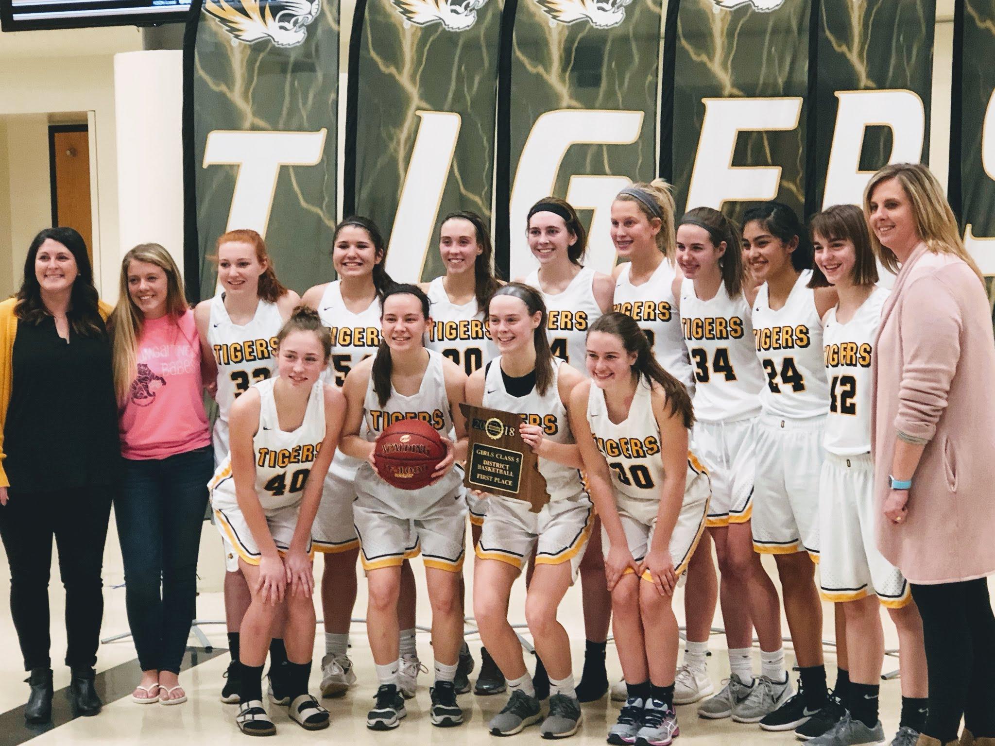 Oakville girls' basketball team wins first district championship