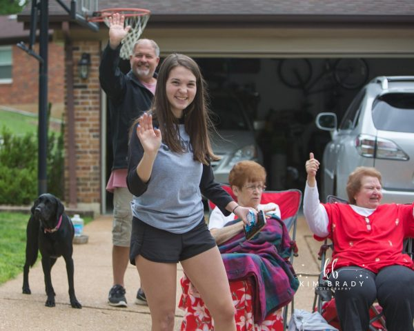 Oakville High graduates like Lauren Long, above, and their families celebrated the Class of 2020's achievements with a drive-by graduation parade last week. Officials still hold out hope that despite the coronavirus pandemic, in-person graduation ceremonies can be held later this summer.