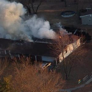 The house near Becker Road engulfed in flames Wednesday evening, as captured by resident Eric Kunst's drone.