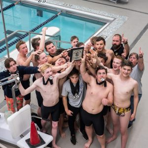 The Oakville boys varsity swim team celebrates its conference championship Nov. 5 at Clayton High School. Photo by Carly Sullens Photography.