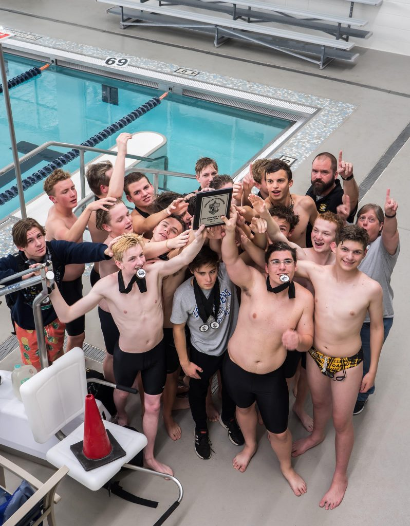 The+Oakville+boys+varsity+swim+team+celebrates+its+conference+championship+Nov.+5+at+Clayton+High+School.+Photo+by+Carly+Sullens+Photography.