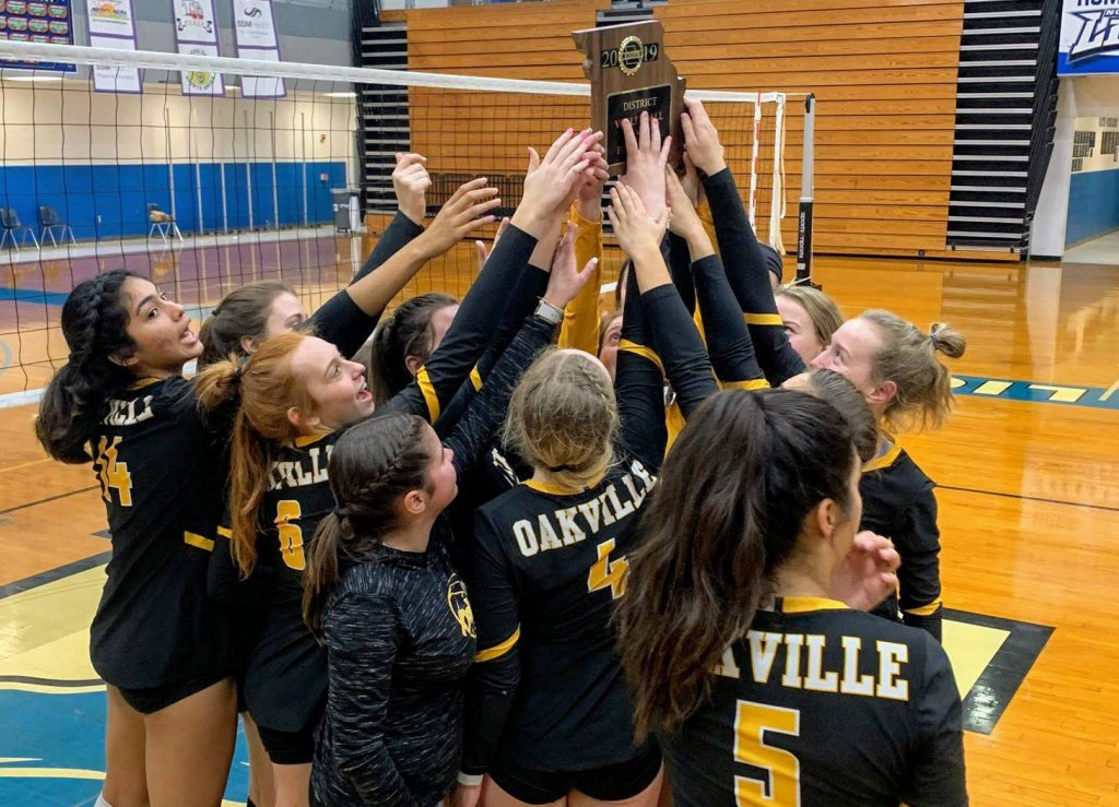 The+2019+Oakville+Tigers+volleyball+team+celebrates+winning+the+district+championship+Wednesday+in+House+Springs.