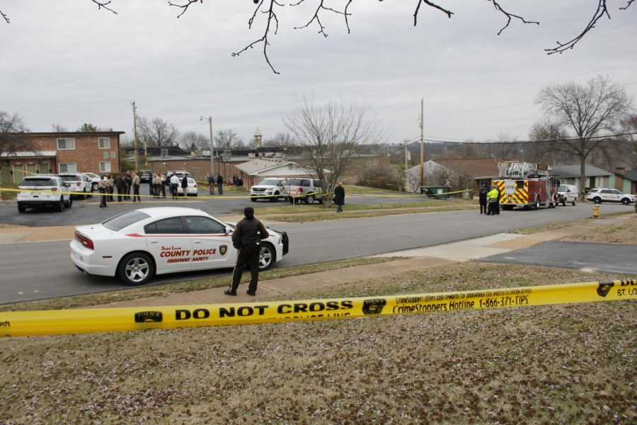 Officers and firefighter-medics respond to the site of the officer-involved shooting at Nottingham Estates in March 2019.