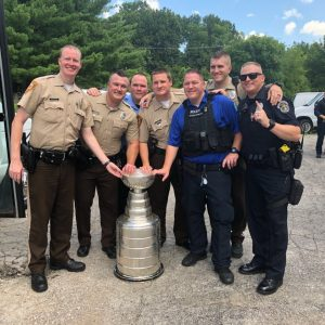 Former Blues player Pat Maroon started off his day with the Stanley Cup by taking photos with his family at his home in Clayton. Maroon then paid a visit to All American ice rink in Green Park, where St. Louis County Police officers, including Green Park Officer Jeremy Hake, posed for photos with Maroon and Stanley. After eating toasted raviolis from the Cup at Charlie Gitto's on The Hill, Maroon then finished the day on a lake to the west of St. Louis with family and friends, and a private concert from country star Adam Sanders.