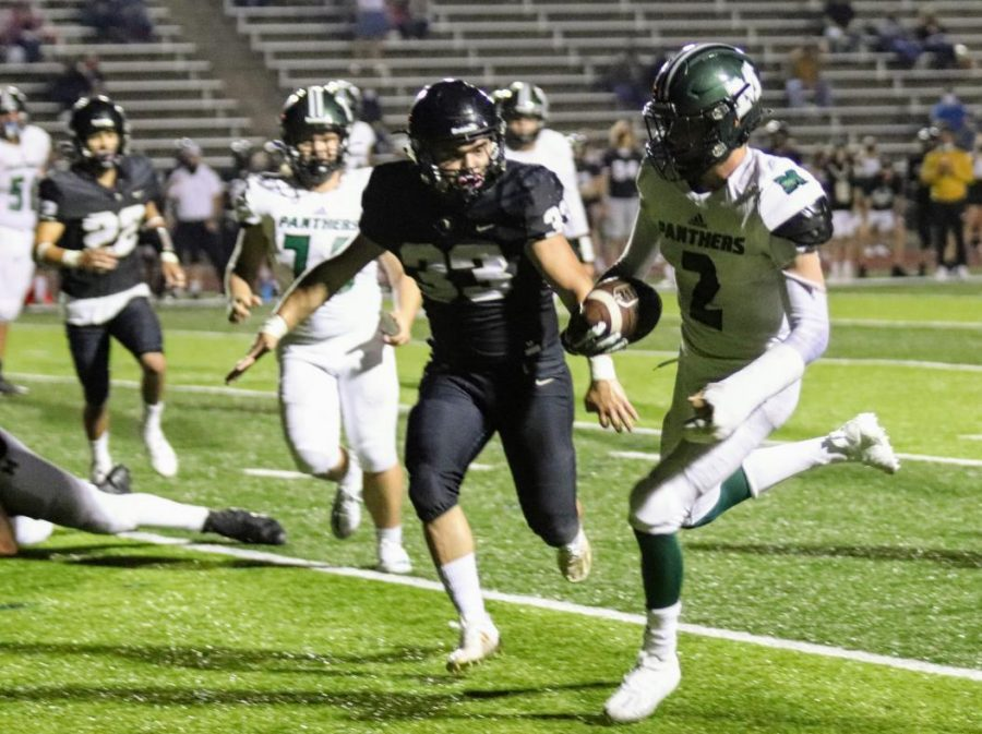 Above, Mehlville's Eric Ohmer (No. 2) scores the winning touchdown with less than two minutes to go in the Oct. 9 game, flanked by Dino Pajazetovic (No. 33) of Oakville.