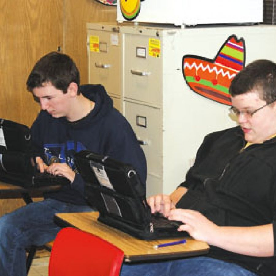Then-freshmen Tyler Fendler, left, and Paul Suntrup, students in Allison Braun's communications arts class at Mehlville Senior High, are shown with the laptops they received for the district's One-to-One Open Source Pilot Program.