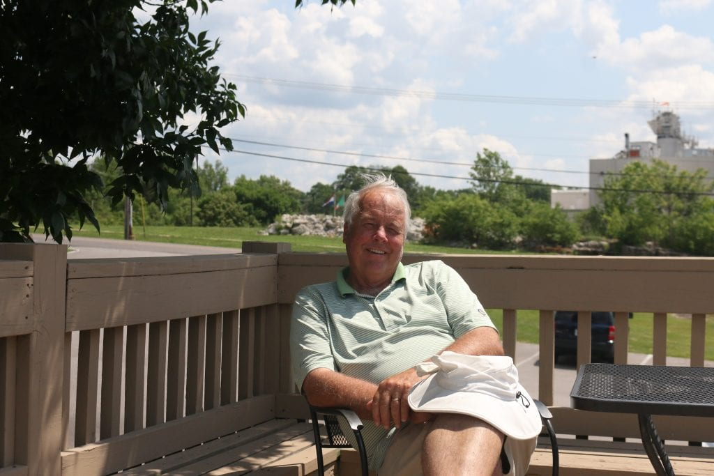 Owner+Steve+Lotz+poses+on+the+patio+overlooking+his+golf+course.+Photo+by+Jessica+Belle+Kramer.