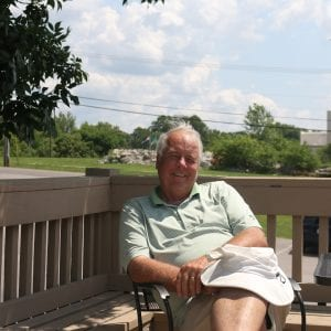 Owner Steve Lotz poses on the patio overlooking his golf course. Photo by Jessica Belle Kramer.