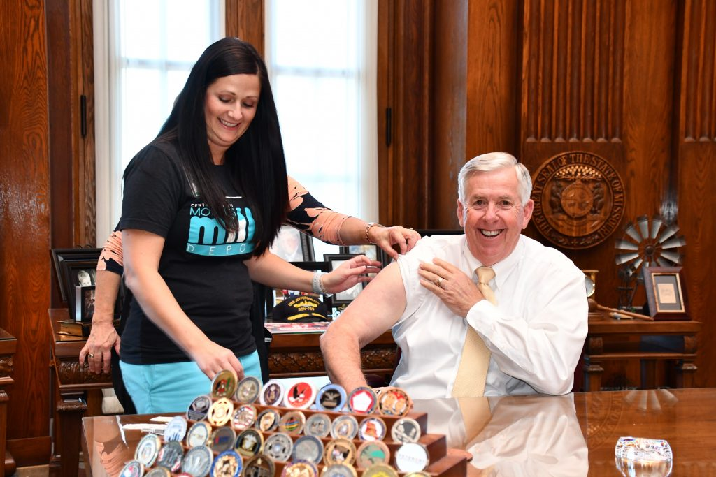 Gov. Mike Parson gets his flu shot in October 2019.