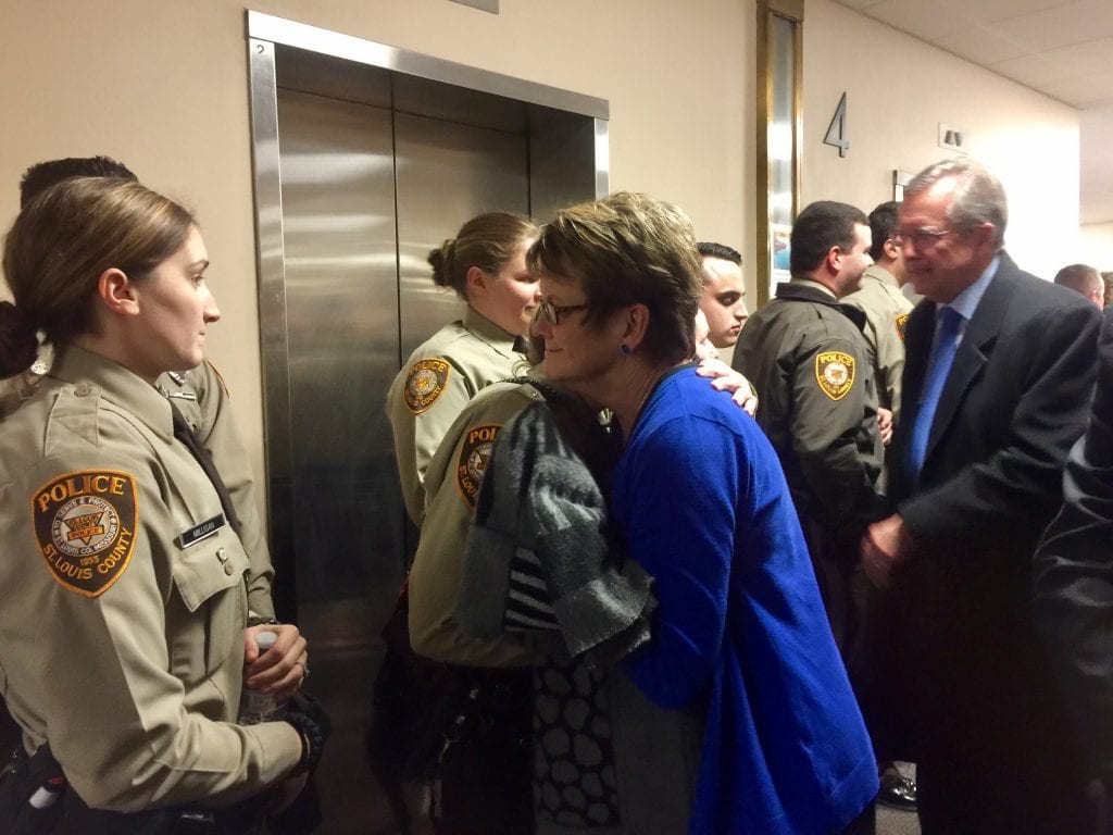 Peggy Snyder, Officer Blake Snyder's mother, hugs a Green Park officer after the jury convicted Trenton Forster of first-degree murder in the killing of Officer Snyder. Photo by Gloria Lloyd.