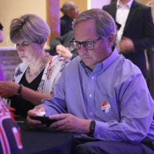 County Counselor Peter Krane keeps an eye on election results at County Executive Steve Stenger's Aug. 7 watch party. A Charter amendment on the ballot will determine whether Krane continues to serve as the only attorney for St. Louis County or not. Photo by Jessica Belle Kramer.