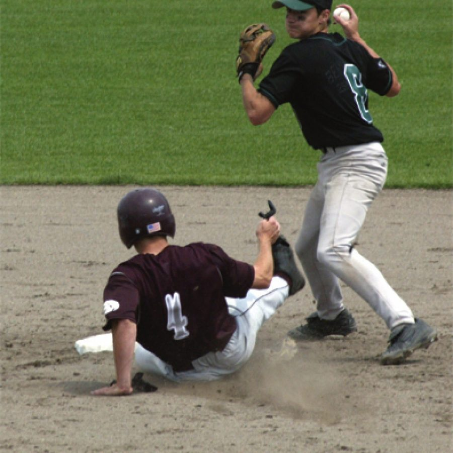 Mehlville High second baseman Josh Ruble, No. 8 in the top photograph, forces DeSmets Greg Davenport at second base and then steps to the outside of the base path to relay a throw to first and complete one of three double plays turned in by the Panthers during Missouri semifinal baseball action in Columbia.