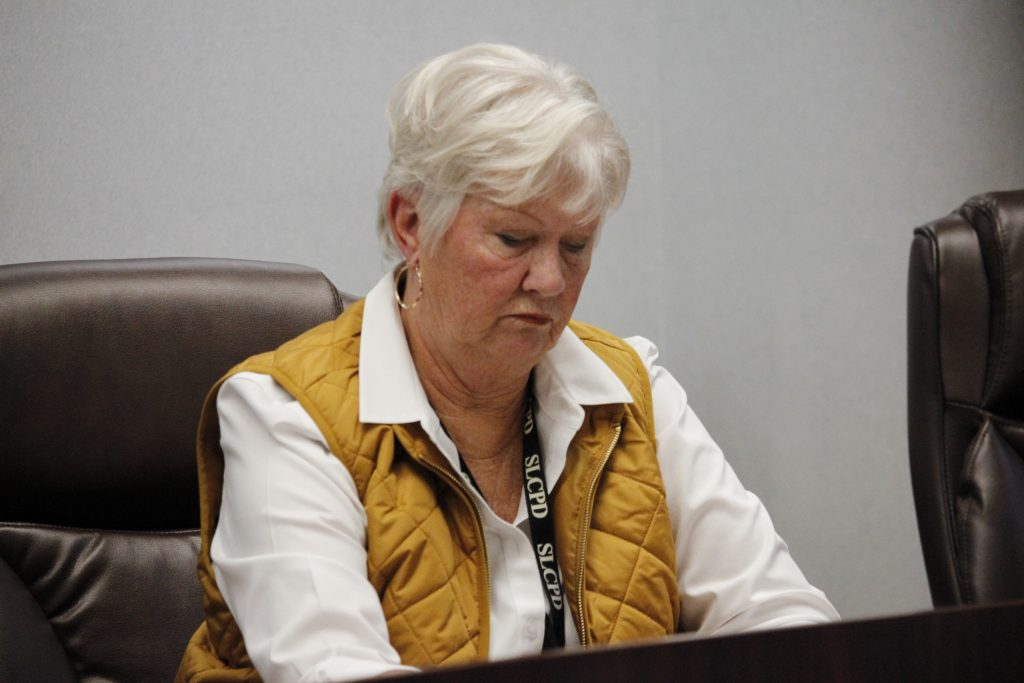 Pictured above: Police board member Laurie Westfall, left, speaks during an emergency board meeting Tuesday.  Photo by Erin Achenbach.