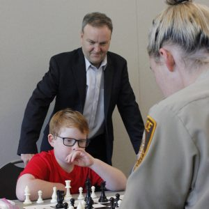 County Executive Sam Page, above, joined the fun last week when he stopped by 'Cops Helping Enhance Student Skills' at The Pavilion at Lemay. C.H.E.S.S. is a way for officers to work with students over the game. Students learned chess from officers in the Police Athletic League during July classes. Photo by Erin Achenbach.