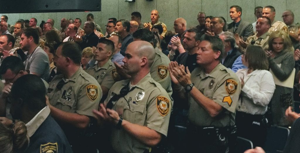 Officers+and+sergeants+from+the+St.+Louis+County+Police+Department+applaud+as+fellow+officer+and+union+representative+Derek+Machens+calls+for+raises+at+an+Oct.+12%2C+2017%2C+hearing+at+the+County+Council.