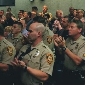Officers and sergeants from the St. Louis County Police Department applaud as fellow officer and union representative Derek Machens calls for raises at an Oct. 12, 2017, hearing at the County Council. Photo by Gloria Lloyd.