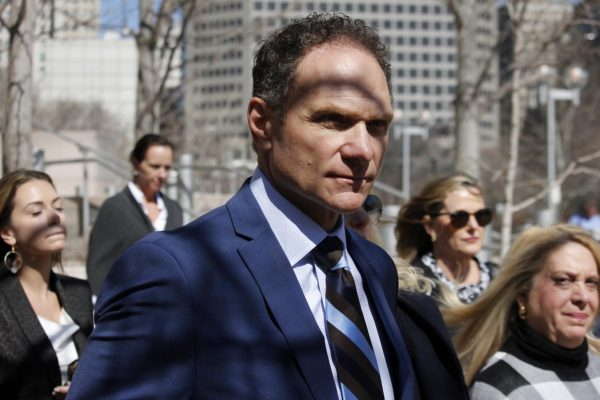 John Rallo exits the Thomas F. Eagleton Federal Courthouse Thursday, March 5 after being sentenced to 17 months in prison for his role in a federal corruption case involving former St. Louis County Executive Steve Stenger.