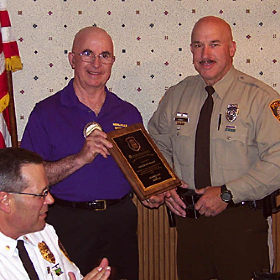 St. Louis County Police Department Officer Joseph Brandt recently was honored as Officer of the Year by the Mehlville Optimist Club during the club's Respect for Law program. Pictured, from left, are: Lt. Col. Terry Roberds, Respect for Law Chairman Richard Behnke and Brandt.