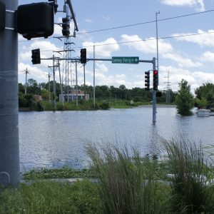 River City Boulevard, at the intersection of Lemay Ferry Road, is inaccessible due to rising floodwater from the River des Peres Thursday, May 30. The Mississippi River, which backs up into the River des Peres, is expected to crest Saturday. Photo by Erin Achenbach.
