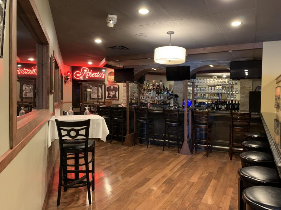 Plexiglas shields protect Roberto's patrons from one another, as seen in June 2020 when restaurants could reopen to indoor dining in St. Louis County after a stay-at-home order.