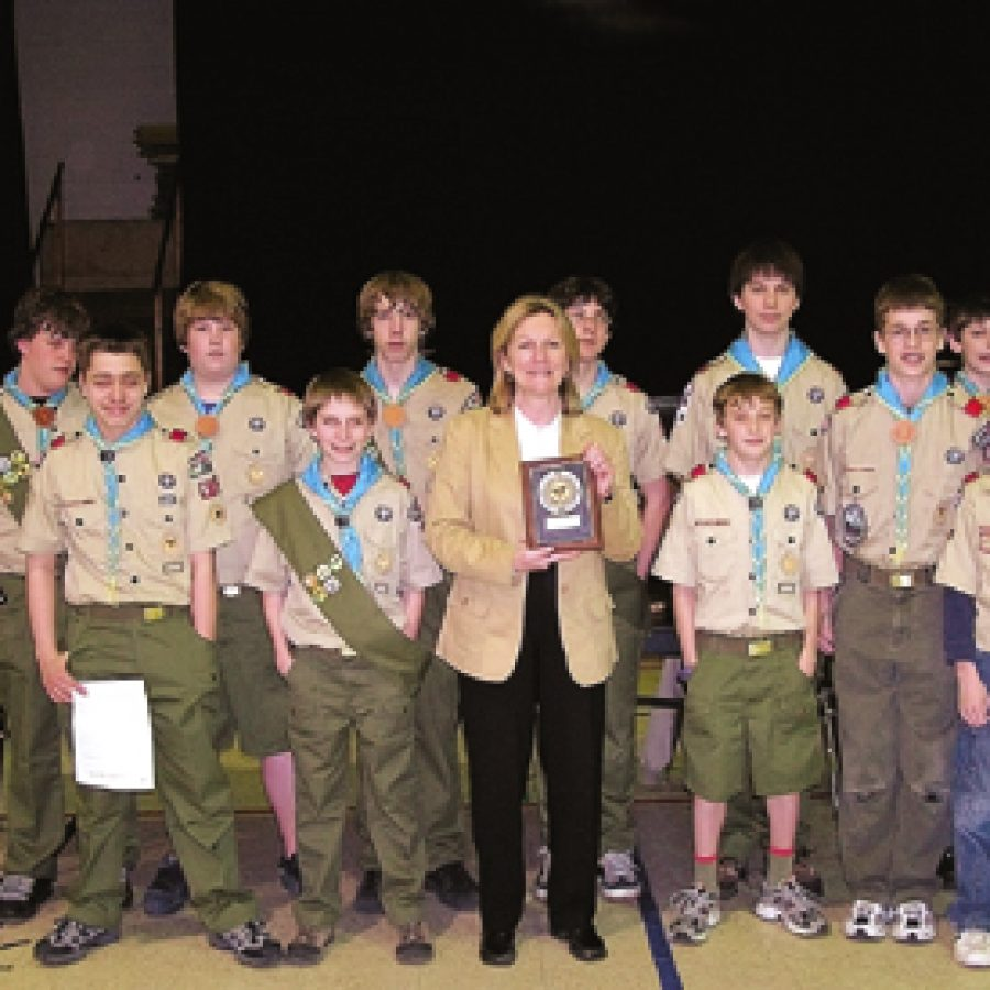 Members of Boy Scout Troop 661 who participated in the troop's 40th anniversary celebration, back row, from left, are: Nathan Vancil, Kevin Lieb, Sean Jones, Eric Ege Jr., Austin Chambliss and Tyler Wolk. Front row, from left, are: Rob Mitchell, Sean Chambliss, Point Elementary Principal Nancy Zitzmann, Eric Mangels, Austin Karpel and Sam Ranzetta.