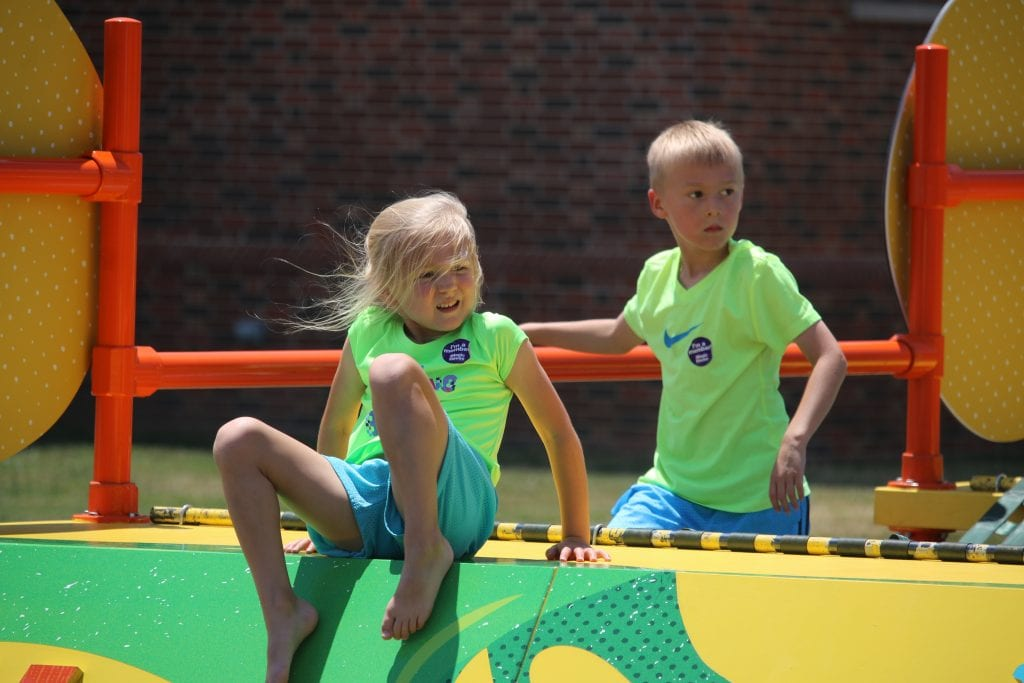 Siblings+Anders+and+Vaeya+Rhodes+climb+on+The+Magic+House+playground+in+summer+2018.+They+both+wore+neon+green+shirts+to+the+event%2C+so+that+they%27d+match.+Photo+by+Jessica+Belle+Kramer.