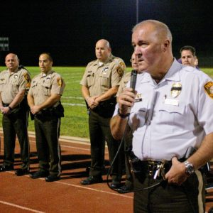 Chief Jon Belmar, right, speaks at the memorial for Officer Blake Snyder held at Affton High School the night Snyder was killed, Oct. 6, 2016, with Sgt. Keith Wildhaber, second from left, looking on. Photo by Bill Milligan.