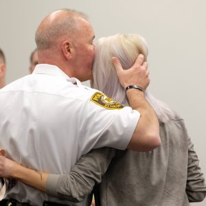 Elizabeth Snyder, right, is consoled by St. Louis County police chief Jon Belmar, left, following the sentencing for Trenton E. Forster Thursday, April 18, 2019, in Clayton. Forster, 20, was found guilty of first degree murder and sentenced to life in prison in the 2016 shooting death of St. Louis County police officer Blake Snyder. (AP Photo/Jeff Roberson)