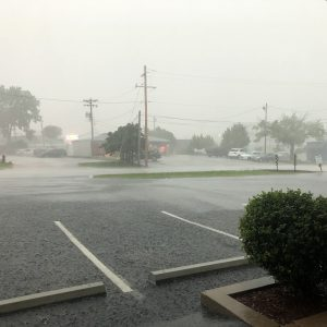 Heavy rain pounds a strip mall in Green Park Wednesday. Photo by Erin Achenbach.
