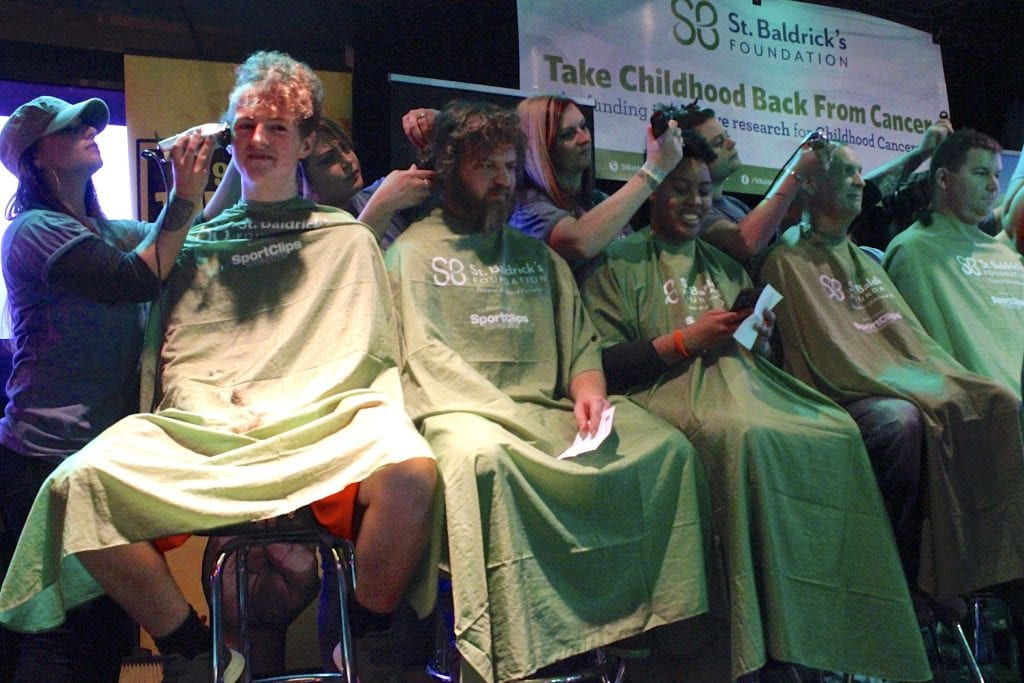 Participants+shave+their+heads+in+exchange+for+audience+donations+to+St.+Baldrick%27s+during+a+%22Rock+the+Bald%22+challenge+at+Helen+Fitzgerald%27s+on+March+9.+Photo+by+Erin+Achenbach.