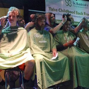 Participants shave their heads in exchange for audience donations to St. Baldrick's during a