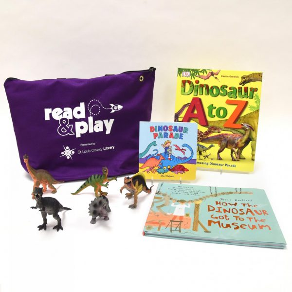 A St. Louis County Library Read & Play Kit featuring dinosaurs.