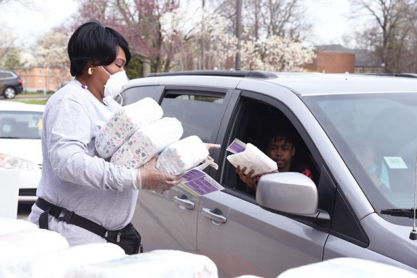 A volunteer hands out free diapers at the Natural Bridge Branch of the St. Louis County Library this week.