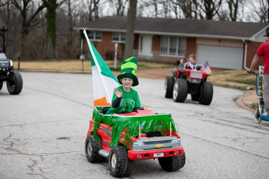 The Stanzes' son Ben drove his toy electric pickup truck with a green grass skirt around the bed and a big Irish flag angled up off the tailgate, topping off his entry with a furry green stovepipe hat.