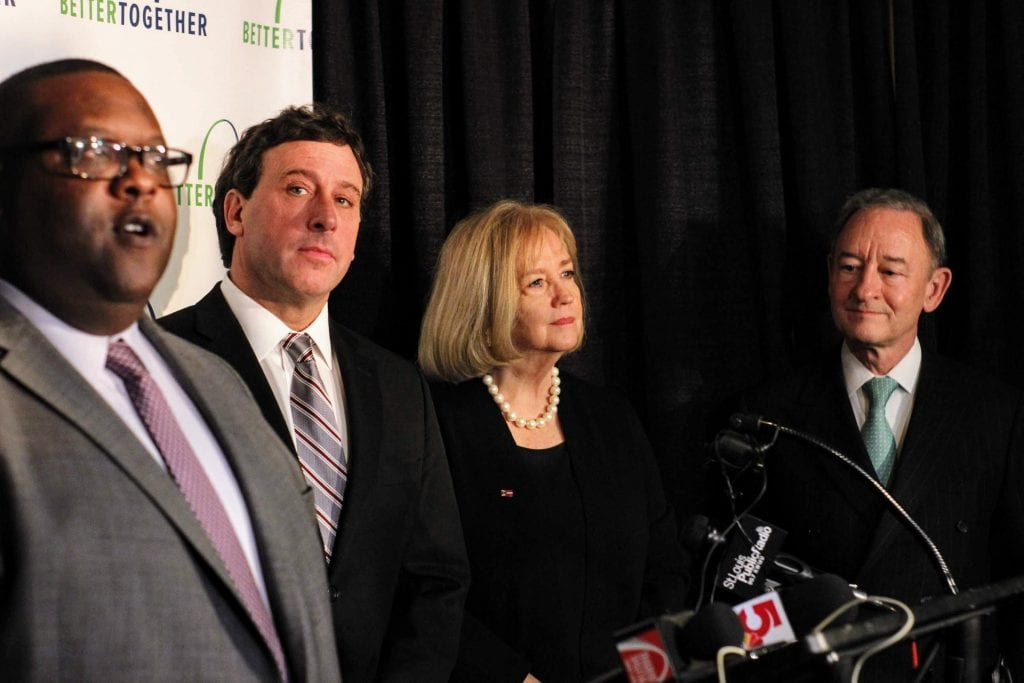 Above, some of the chief backers of the Better Together movement for one St. Louis and a city-county merger talk about the plan at its rollout at the Cheshire Inn Jan. 28, 2019, including, from left to right, Better Together Deputy Director of Community-Based Studies Marius Johnson-Malone, former St. Louis County Executive Steve Stenger, St. Louis Mayor Lyda Krewson and Washington University Chancellor Mark Wrighton, who led the campaign for a 2020 statewide vote on the merger. Photo by Erin Achenbach.