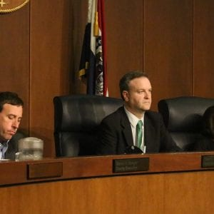 Then-County Executive Steve Stenger, then-County Council Chairman Sam Page and then-1st District Councilwoman Hazel Erby listen to speakers at the July 24, 2018 council meeting. Photo by Jessica Belle Kramer.