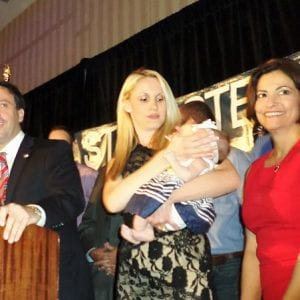 Steve Stenger, left, celebrates his Democratic primary victory in August 2014, along with, from left, Stenger's wife Allison, their daughter Madeline Jane and Stenger's legislative assistant Linda Henry. Photo by Gloria Lloyd.