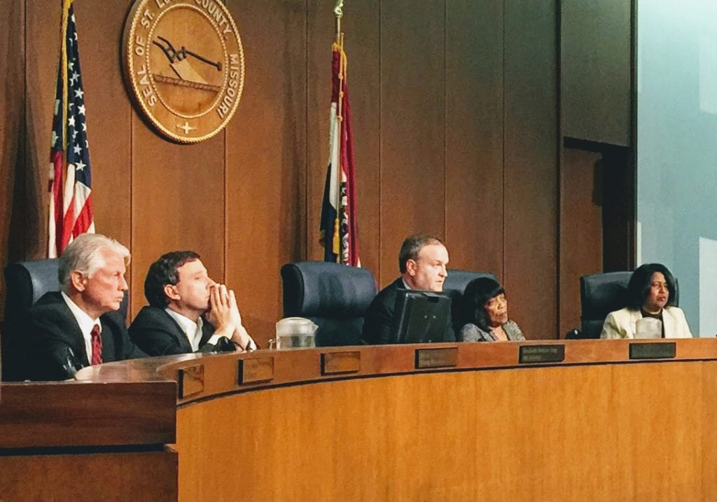 County Executive Steve Stenger, second from left, listens to Rep. Bob Burns, D-Affton, address the council last year, left to right: 5th District Councilman Pat Dolan, D-Richmond Heights, Chairman Sam Page, D-Creve Coeur, 1st District Councilwoman Hazel Erby and 4th District Councilwoman Rochelle Walton Gray, D-Black Jack. Photo by Gloria Lloyd.